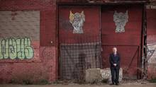Roy Norton stands beside some derelict buildings in Detroit where the proposed new bridge between Canada and the United States is to be erected. (GEOFF ROBINS/The Globe and Mail)