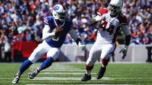 Tyrod Taylor #5 of the Buffalo Bills out runs Markus Golden #44 of the Arizona Cardinals during the first half at New Era Field on September 25, 2016 in Orchard Park, New York. (Tom Szczerbowski/Getty Images)