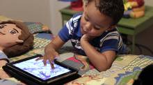 Frankie Thevenot, 3, plays with an iPad in his bedroom at his home in Metairie, La. About 40 per cent of 2- to 4-year-olds (and 10 per cent of kids younger than that) have used a smartphone, tablet or video iPod, according to a new study by the nonprofit group Common Sense Media. (Gerald Herbert/Gerald Herbert/AP)