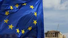 A European Union flag is seen in front of the Parthenon temple in Athens last month. (JOHN KOLESIDIS/JOHN KOLESIDIS/REUTERS)