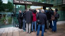 "Media gather at the entrance to B.C. Supreme Court on the first day of the ""Surrey Six"" murder trial in Vancouver, B.C., on Monday September 30, 2013 to hear a victim's mother speak. (Darryl Dyck For The Globe and Mail)"