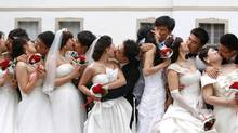 While it's easy to get swept up in the romance of a wedding, marriage is also a contract that comes with weighty financial decisions: will you take on each other's debts and assets? Are you going to merge all your money or keep some separate? And how are you going to divvy up bill payments and other responsibilities? (Michaela Rehle/REUTERS)