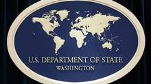 A veteran State Department employee has been arrested on charges that she made false statements to federal investigators.