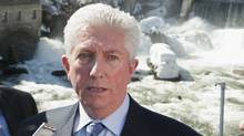 Bloc quebecois Leader Gilles Duceppe, right, responds to media questions while standing near the Hyatt falls following a nomination meeting Sunday, April 3, 2011, in Sherbrooke Que. (Jacques Boissinot/The Canadian Press/Jacques Boissinot/The Canadian Press)