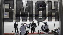 A dozen Pittsburgh Penguins players, including captain Sidney Crosby, participate in an informal workout a day after the end of the NHL labor lockout in Pittsburgh, Monday, Jan. 7, 2013. (Gene Puskar/AP)
