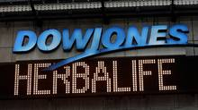 "A news headline displaying ""Herbalife"" is seen under the DowJones electronic ticker at Times Square in New York January 9, 2013. (SHANNON STAPLETON/Reuters)"