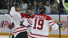 Canada's Ryan Murphy, Jonathan Drouin and Mark Scheifele celebrate Drouin's goal against Russia (Mark Blinch/Reuters)