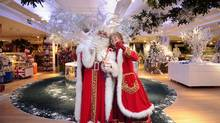 Father Christmas and Mrs Christmas pose for photographers at Harrods department store in central London on July 28, 2011, (CARL COURT/AFP/Getty Images)