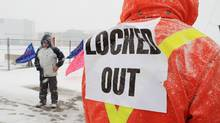 Locked-out workers and supporters picket at the Electro-Motive plant in London, Ont., in January. (DAVE CHIDLEY/THE CANADIAN PRESS)
