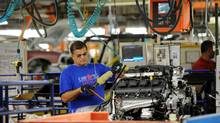 Chrysler employees assemble cars at the assembly plant in Brampton, Ont. on Jan. 7, 2011. (Kevin Van Paassen/The Globe and Mail)