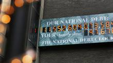 The National Debt Clock in New York, which shows the U.S. national debt. (SHANNON STAPLETON/REUTERS)
