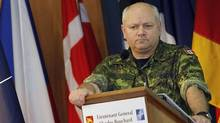 Canadian Lieutenant General Charles Bouchard, commander of the NATO military operations in Libya, listens to a reporter's question during a media briefing at the NATO's Southern Europe headquarters in Naples March 28, 2011. (REUTERS/STRINGER/ITALY/REUTERS/STRINGER/ITALY)