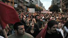 Demonstrators march to protest government austerity measures in Greece Sept. 11 (LOUISA GOULIAMAKI)