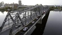 Cars travel on the Alexandra bridge between Ottawa and Gatineau during rush hour on Oct. 18, 2012. Ottawa and the provinces are poised to unveil a sweeping new agreement to liberalize interprovincial trade (Lars Hagberg/The Canadian Press Images)