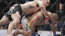 Cain Velasquez, left, lands a punch to the face of Antonio Silva in the first round of the UFC 160 mixed martial arts heavyweight title bout, Saturday, May 25, 2013, in Las Vegas. Velasquez won by technical knockout. (Julie Jacobson/AP)