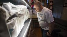 Jean-Pierre Forest is pictured in his home near a piece of the plane that he was in when it crashed leaving him with a brain injury in Richmond, British Columbia on March 24, 2016. (Ben Nelms/The Globe and Mail)