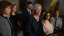 "Chair of the House of Commons Standing Committee on the Status of Women Marilyn Gladu speaks surrounded by committee members after tabling the report entitled ""Taking Action to End Violence Against Young Women and Girls in Canada,"" Monday, March 20, 2017 in Ottawa. (Adrian Wyld/THE CANADIAN PRESS)"