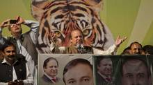 Nawaz Sharif, middle, leader of the Pakistan Muslim League, addresses an election rally in Islamabad on May 5. Pakistan's general elections will be held on Saturday. (MIAN KHURSHEED/REUTERS)
