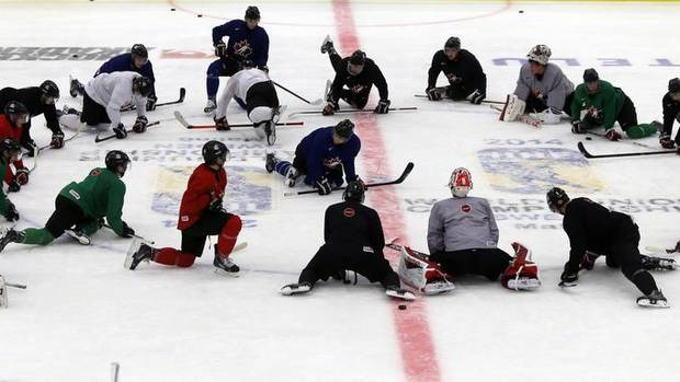 Team Canada players take a knee during practice at the IIHF World Junior Championship in Malmo December 29, 2013. (ALEXANDER DEMIANCHUK/REUTERS)