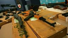 Toronto police show off guns seized in a 2005 raid. (Jim Ross/Jim Ross for The Globe and Mail)