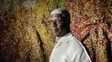 Ghanaian visual artist El Anatsui and his work at Toronto's Royal Ontario Museum. (Moe Doiron/The Globe and Mail)