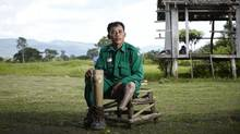 Yi Am planted mines as a soldier and then lost much of a leg when he stepped on one. Now, he supports his family by making farmers' fields safe again, a job he says he wants to do 'forever.' (samjam For The Globe and Mail)