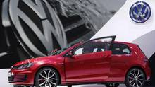 A new model of the Volkswagen Golf GTI is displayed on media day at the Paris Mondial de l'Automobile September 27, 2012. (CHRISTIAN HARTMANN/REUTERS)