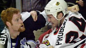Former Chicago Blackhawks' winger Bob Probert, right, in a fight with Gordie Dwyer on Jan. 4, 2002 in Chicago.