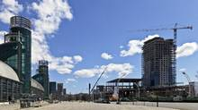 Hotel X, right, is designed to attract convention goers to the CNE grounds and the Direct Energy Centre, left, in Toronto. (Wallace Immen for The Globe and Mail)
