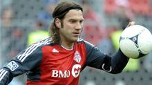 Toronto FC's Torsten Frings knocks down a ball during the first half of their MLS soccer match against the Chicago Fire in Toronto April 21, 2012. REUTERS/ Mike Cassese (MIKE CASSESE)