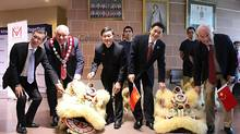 From left, Ontario minister Michael Chan, Markham Mayor Frank Scarpitti, president of Markham Cultural Centre Dr. Ken Ng, Toronto Consul-General of the People's Republic of China Xue Bing and John McCallum commemorate the founding day of the People's Republic of China.