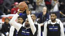 LeBron James takes a half-court shot during practice for the NBA all-star game at Ricoh Coliseum in Toronto on Saturday. (Peter Llewellyn/USA Today Sports)