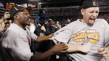 San Francisco Giants Aubrey Huff and coach Shawon Dunston (L) celebrate defeating the Texas Rangers in Game 5 to win Major League Baseball's World Series in Arlington, Texas, November 1, 2010. REUTERS/Mike Segar (© Mike Segar / Reuters)