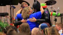 John Buckman, dressed as Batman, hugs the aunt of Jacob Hall after speaking during the superhero-themed funeral service for Jacob at Oakdale Baptist Church on Oct. 5, 2016, in Townville, S.C. (Ken Ruinard/AP)