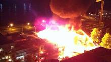A photo posted to Twitter show buildings in New Westminster, B.C., ablaze. (Alix Cote)