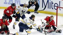 Buffalo Sabres' Ryan O'Reilly (90) scores on Ottawa Senators goaltender Craig Anderson (40) as Senators' Mark Borowiecki (74) and Cody Ceci (5) and Sabres' William Carrier (48) look on during first period NHL hockey action in Ottawa Tuesday, November 29, 2016. (FRED CHARTRAND/THE CANADIAN PRESS)