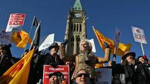 ACTRA president Ferne Downey leads a rally on Parliament Hill in November of 2009. (Fred Chartrand/The Canadian Press)