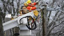 Toronto Hydro workers repair primary conductors on Queen Street East on Dec. 23, 2013. (FRED LUM/THE GLOBE AND MAIL)