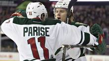 Minnesota Wild's Zach Parise (11) and Mikael Granlund (64) celebrate a goal against the Edmonton Oilers during first period NHL hockey action in Edmonton, Alta., on Thursday February 27, 2014 (The Canadian Press)