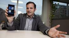 Jeff Gadway, senior manager in product marketing at RIM, shows the coming BlackBerry 10. (Deborah Baic/The Globe and Mail)