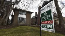 A real estate sign on the front lawn of a Sherbourne Street home in Toronto's Rosedale neighbourhood on Dec. 30, 2014. (Fred Lum/The Globe and Mail)