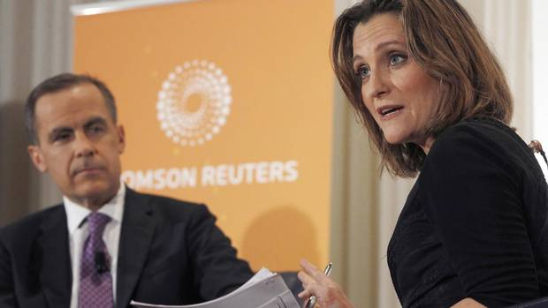 Bank of Canada Governor Mark Carney (L) is interviewed by Chrystia Freeland, Thomson Reuters Managing Director and Editor, Consumer News, at the National Press Club in Washington April 18, 2013.