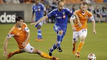 Montreal Impact midfielder Justin Mapp avoids the tackle from Houston Dynamo defender David Horst during the first half at BBVA Compass Stadium. (USA TODAY Sports)