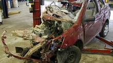 The vehicle in which four high school students were killed in a Saturday night collision is seen inside the garage of a Moncton car dealership on Monday, Sept. 10, 2007. (Viktor Pivovarov/The Canadian Press)