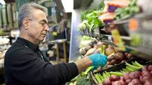 A grocer tends to produce at a Vancouver store on May 12, 2010. (Brett Beadle/Brett Beadle for The Globe and Mail)