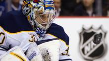 Buffalo Sabres goalie Ryan Miller watches the puck after making a save against the Vancouver Canucks during the first period of an NHL hockey game in Vancouver, B.C., on Saturday March 3, 2012. THE CANADIAN PRESS/Darryl Dyck (Darryl Dyck/CP)