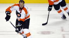 Philadelphia Flyers' Chris Pronger warms up before Game 6 of a first-round NHL Stanley Cup playoffs hockey series between the Flyers and the Buffalo Sabres in Buffalo, N.Y., Sunday, April 24, 2011. (David Duprey)