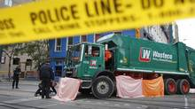 Images from the scene where a Wasteco garbage truck has run over and killed a young male at the intersection of King and Spadina streets in Toronto on Oct. 21, 2011. (Peter Power/The Globe and Mail/Peter Power/The Globe and Mail)