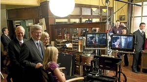 Prime Minister Stephen Harper and his daughter Rachel take a behind-the-scenes look TV series Murdoch Mysteries on set in Toronto on Oct. 14, 2010.