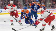 Carolina Hurricanes' Phil Di Giuseppe (34) and Jordan Staal (11) get in front of Edmonton Oilers' Andrej Sekera (2) as Andrew Ference (21) looks on during the second period. (AMBER BRACKEN/THE CANADIAN PRESS)